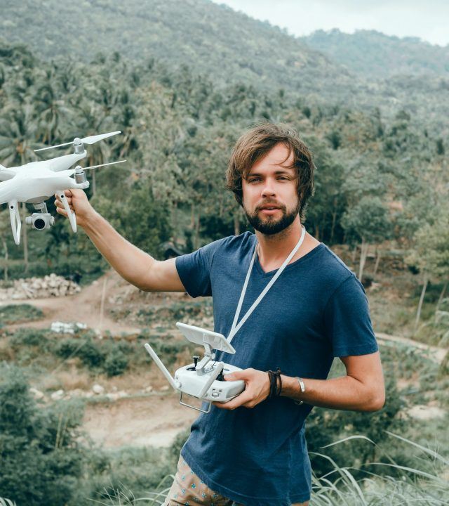 young man uses dron,